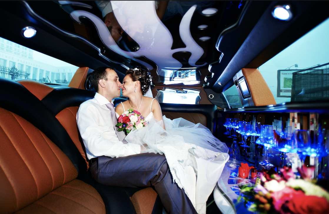 The interior of a wedding limo with a bride and groom.