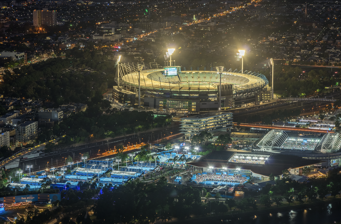 The MCG and tennis stadium in Melbourne at night.