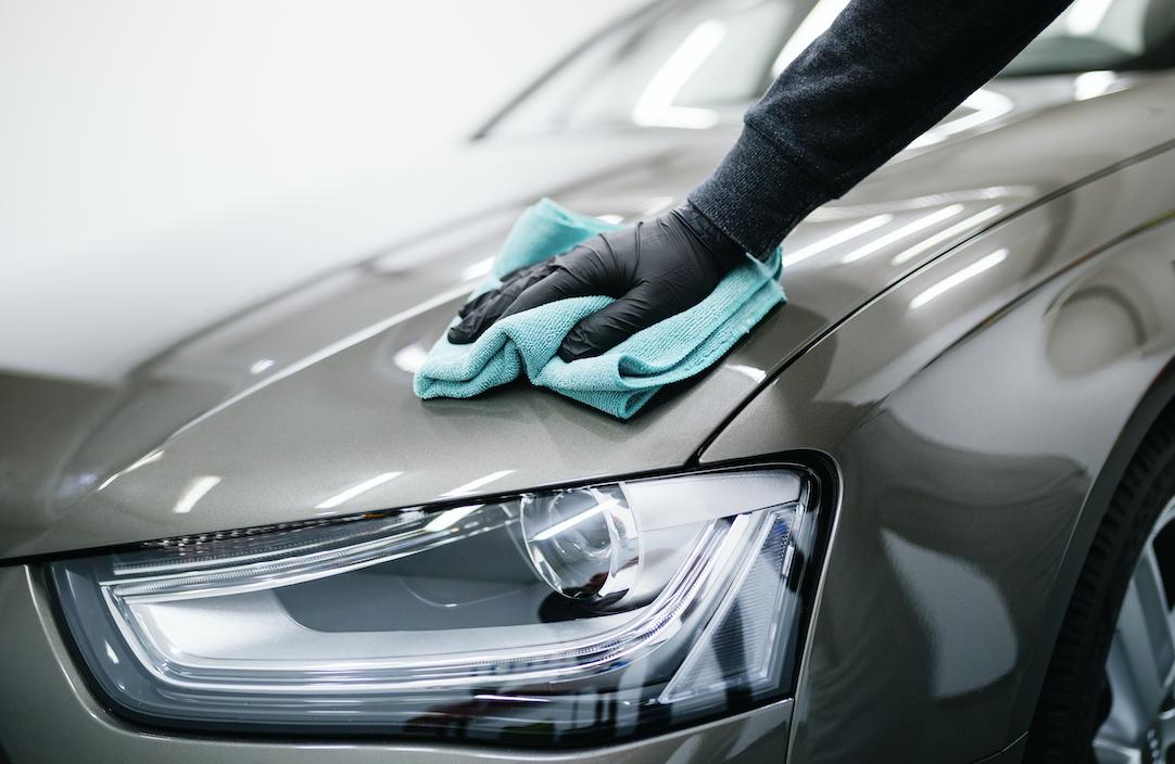 Polishing a grey cars surface.